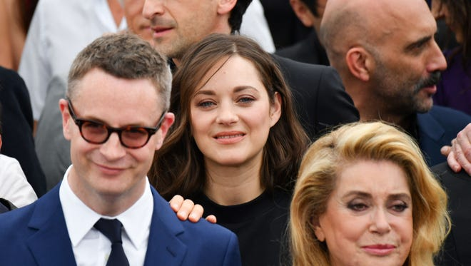 Marion Cotillard, center, is flanked by Nicolas Winding Refn, left, Adrien Brody and Catherine Deneuve at a Cannes photo call.