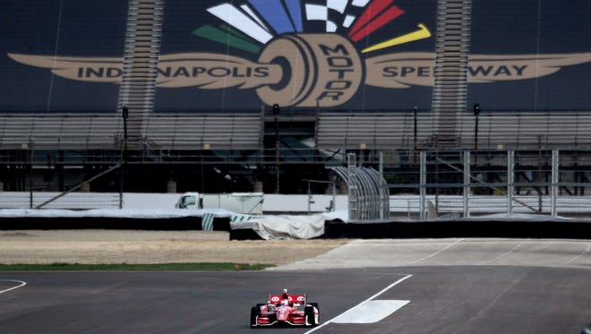 Scott Dixon comes down Hulman during the IndyCar road course test at the Indianapolis Motor Speedway, Wednesday, April 30, 2014, in Indianapolis.