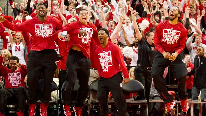 In this Sunday, March 16, 2014 photo,  Nebraska players react seconds after the NCAA Selection Show announced Nebraska's spot in the NCAA tournament.
