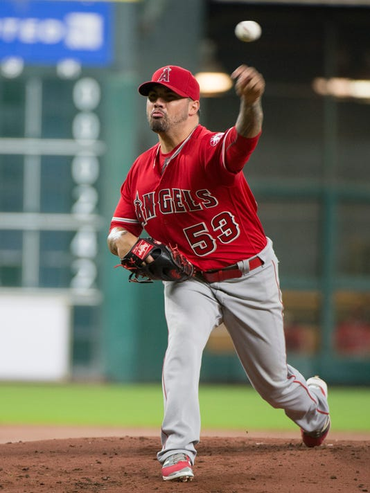 Los Angeles Angels starting pitcher Hector Santiago (53) pitches against the Houston Astros during the first inning of a baseball game Tuesday, June 21, 2016, in Houston. (AP Photo/George Bridges)