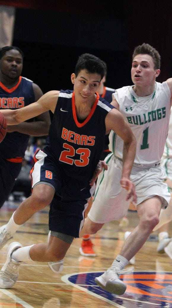 Briarcliff's Miles Jones drives on Irvington's Chris