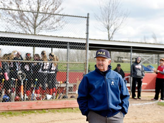 Geno Groft stands on the field before umpiring a softball game Friday at Dover. Groft, 78, just finished refereeing his 49th season of basketball and is in the midst of his 38th season of umpiring softball.