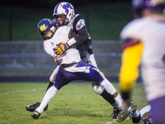 Central's Nahshon Prater stops a run by Marion during