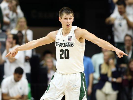 Michigan State guard Matt McQuaid (20) reacts to a