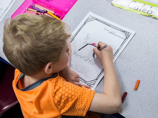 Daleville Elementary School teacher Debbie Hendricks leads her class in a Thanksgiving writing exercise where students write about what they are thankful Thursday morning.