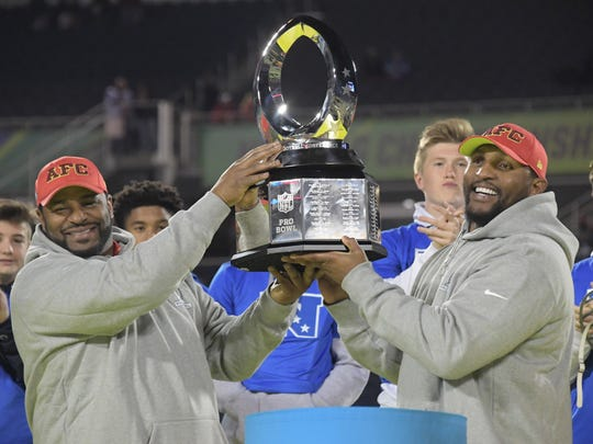AFC legends coach Jerome Bettis (left) and Ray Lewis hold the Pro Bowl trophy during the 2017 Pro Bowl at Camping World Stadium. The AFC defeated the NFC 20-13.
