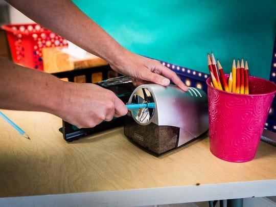 A teacher sharpens pencils in a West View Elementary School classroom.