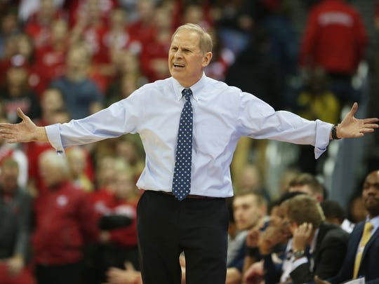 Michigan Wolverines coach John Beilein  reacts to a referee call during the game against the Wisconsin Badgers at the Kohl Center on Sunday, Feb. 11, 2018