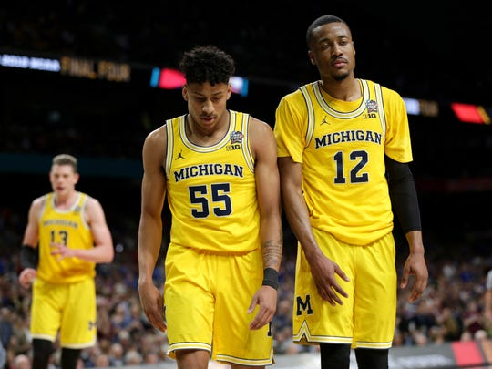 Michigan guard Eli Brooks (55) and guard Muhammad-Ali