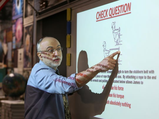 Ben Davis High School Physics teacher Roy Streater gives a lesson about torque, Friday, March 16, 2018.  He has liver disease and is currently on the transplant list awaiting a liver.