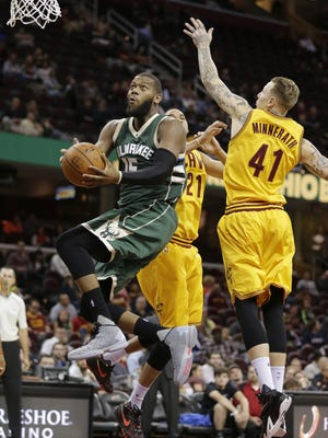 Bucks center Greg Monroe (left) drives to the basket against the Cleveland Cavaliers last season during a preseason game. Monroe, in the second year of a three-year, $50 million deal he signed with Milwaukee in 2015, should help the Bucks when the regular season begins later this month.