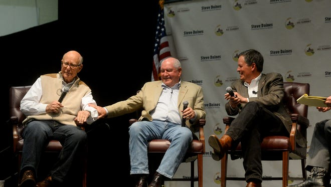 From left: Senator Pat Roberts, Chairman of the U.S. Senate Committee on Agriculture, Nutrition and Forestry, Sonny Perdue, Secretary of the United States Department of Agriculture, and Senator Steve Daines talks during a panel discussion at the Montana Ag Summit in the Four Seasons Arena on Thursday.