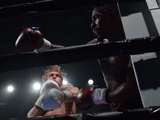 "Alexandria native Clay Burns (left) fought Josh Ross of West Monroe in the Fox Sports ""Toe-To-Toe Tuesdays"" weekly boxing series held Tuesday, July 18, 2017 at the Rapides Parish Coliseum. Ross won by a split decision."