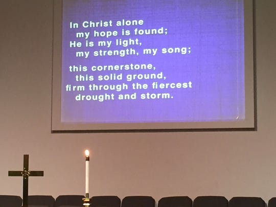 The words to a hymn are projected on a screen during