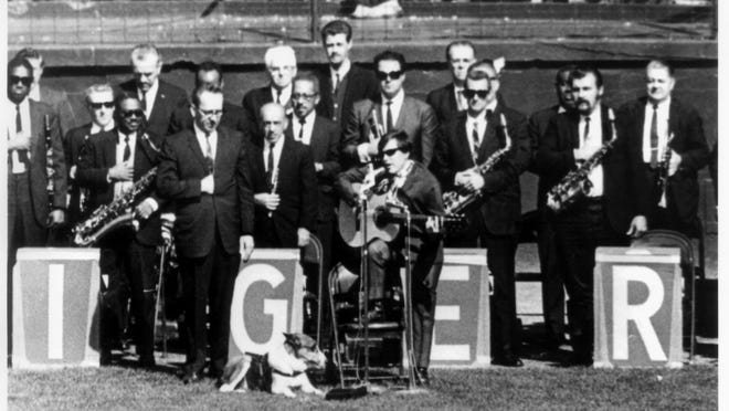 José Feliciano, with his seeing eye dog Trudy, sings the national anthem before a 1968 World Series game at Tiger Stadium.