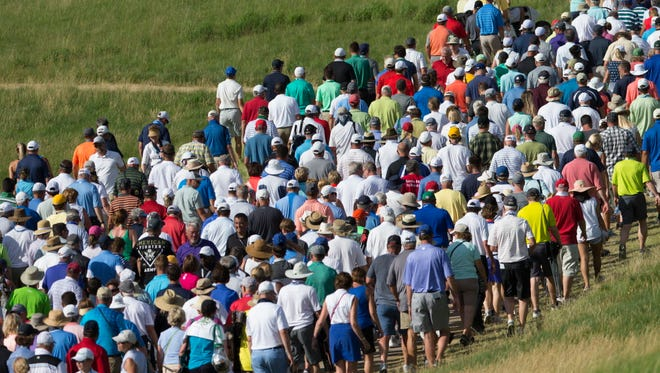 Spectators follow local favorite Steve Sticker on the back nine during the first round of the U.S. Open  on Thursday.