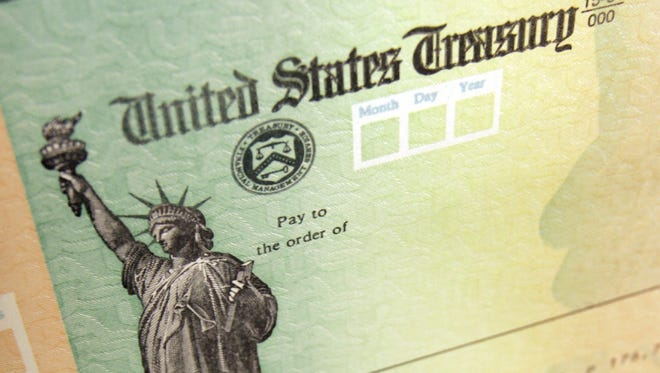 In this May 8, 2008, file photo, blank U.S. Treasury checks are seen on an idle press at the Philadelphia Regional Financial Center, which disburses payments on behalf of federal agencies.