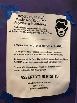 "This flyer, calling for customers to ""Assert Your Rights"", was taped to the storefront windows of several businesses in downtown Lake Worth Beach."