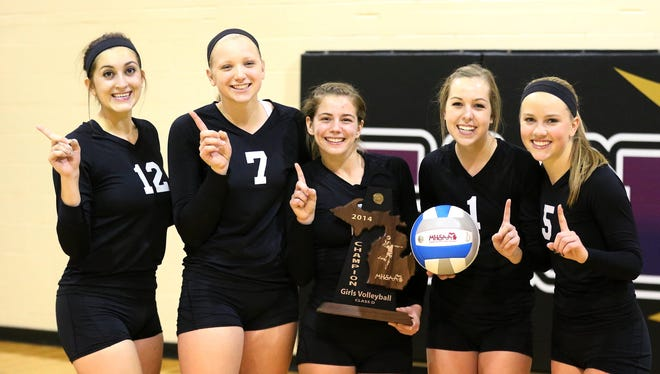 Celebrating with the Class D district trophy are Plymouth Christian seniors (from left) Abby Wyman, Danielle Witkowski, Callie Morby, Kelsey Williamson and Raina Postma.