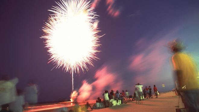 Fireworks on Juneteenth 2001 light up the sky where Martin Luther King Boulevard hits the beach in Galveston.