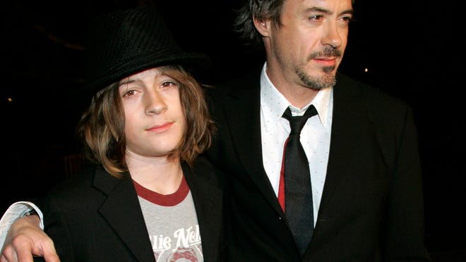 FILE - In this March 1, 2007 file photo, Robert Downey Jr. and his son Indio arrive at a premiere in Los Angeles. Authorities say Indio, the 20-year-old son of actor Robert Downey, Jr. is out on bail after being arrested with what deputies believe was cocaine Sunday, June 30, 2014, after a car he was in was pulled over in West Hollywood. Downey was released shortly after 9 p.m. on $10,250 bail. (AP Photo/Reed Saxon,File) ORG XMIT: LA101