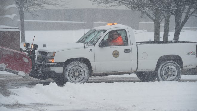 A snowplow clears the sidewalk outside of City Hall in the City of Poughkeepsie.