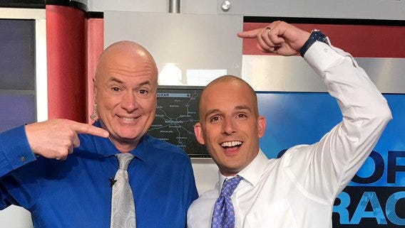 WISH-TV's Randy Ollis sports his newly shaved head with co-meteorologist and barber Marcus Bailey.