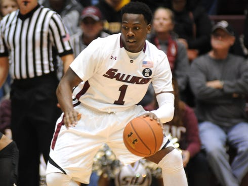 Southern Illinois' Jalen Pendleton (1) dribbles during the first period of a Missouri Valley Conference game at the SIU Arena in Carbondale, Ill.