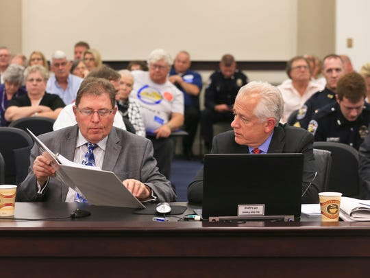 Consultants Adam Reese, left and Mike Nadol of PFM Consulting Group, a group retained by state government to offer recommendations for the state's failing public pension plan, spoke to legislators Monday afternoon.