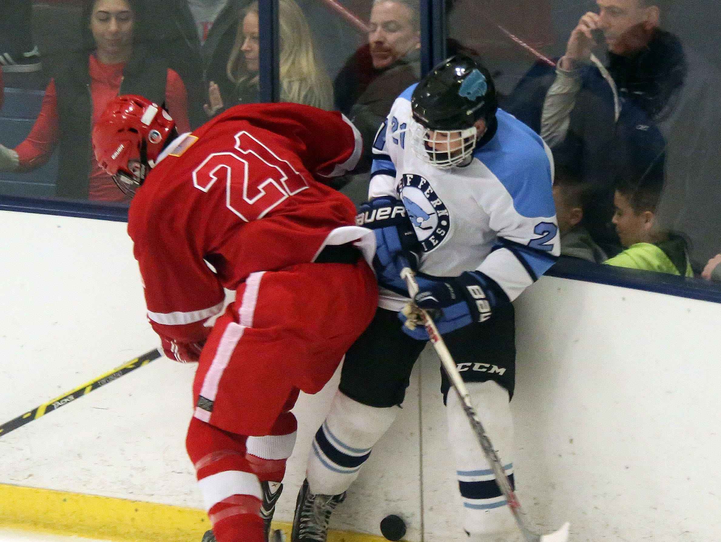 Suffern's Kyle Foresta (21) and North Rockland's Steven Apicella (21) fight for control of the puck during the first period Section 1 Division 1 semifinal hockey at the Sport-O-Rama in Monsey at Feb. 26, 2016.