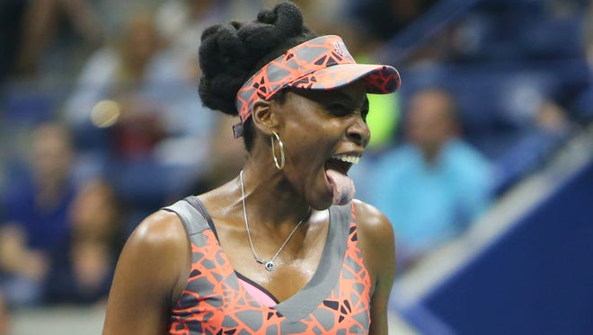 Venus Williams sticks out her tongue during her match against Petra Kvitova during the first set of their quarterfinal match at the U.S. Open at USTA Billie Jean King National Tennis Center in New York.