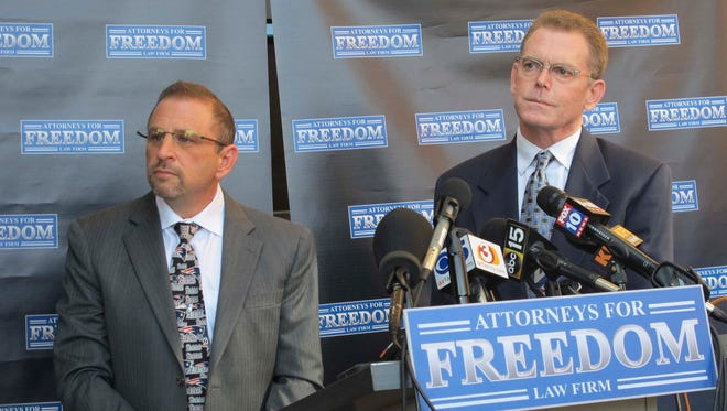 Douglas Haig (right) stands beside his attorney, Marc Victor, at a news conference Feb. 2, 2018, in Chandler. Haig, who is charged with conspiracy to manufacture and sell armor-piercing ammunition without a license, has been given until 5 p.m. Friday to dispose of weapons and ammunition in his possession.