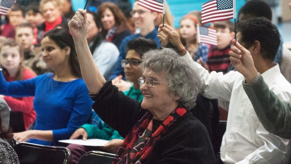 New U.S. citizen Marie Stewart waves the American flag