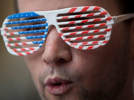 Jack Baumann looks out through American flag glasses