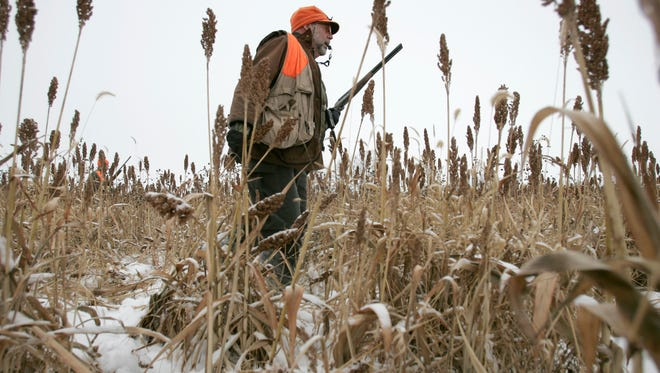 Bruce Deadman of Virchow Krause & Company out of Appleton, pheasant hunts with co-worker Bob Zemple and Kory Brockman at Hunter's Park on Tuesday Dec. 11, 2007. Post-Crescent photo by Patrick Ferron.