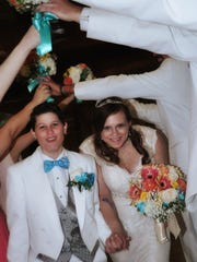 Woodbridge's Amber Schaber (right) and Michele Yacovelli during their May 15 wedding in Scotch Plains.