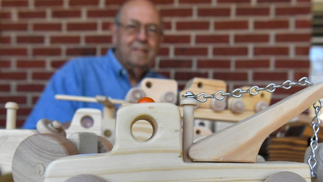 Don Stockton of Columbia has been making wooden toys for 34 years and sells them at local festivals like Pumpkinfest.