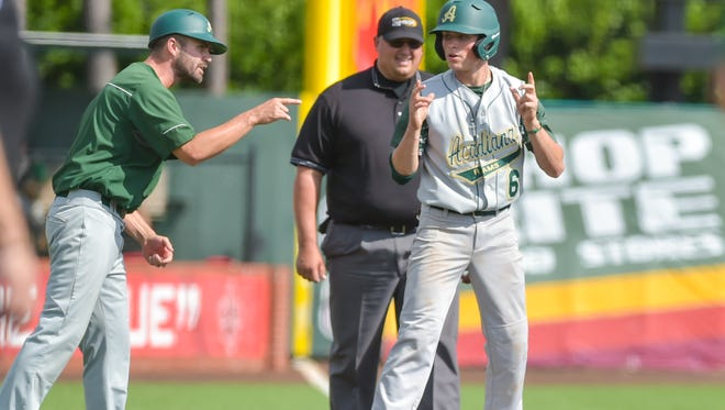 Acadiana High coach Matt McCullough, shown here exhorting a Wreckin' Ram baserunner during the team's state regional upset of No. 2 Lafayette High, was recognized as the Class 5A State Coach of the Year.