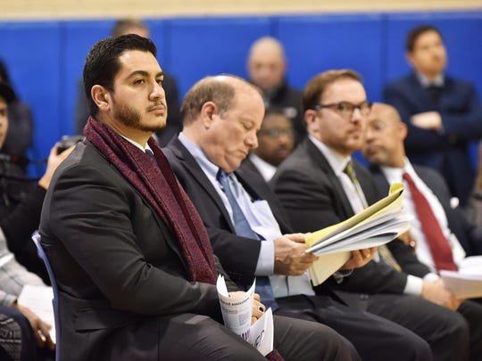 Abdul El-Sayed MD, left, executive director and health officer for the Detroit health department, sits next to Detroit mayor Mike Duggan during a Detroit City Council committee of the whole public hearing regarding Marathon Petroleum Company proposal at Patton Recreation Center in Detroit on Jan. 28, 2016.