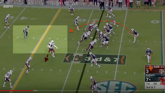 Auburn quarterback Sean White gets a 12-yard gain on