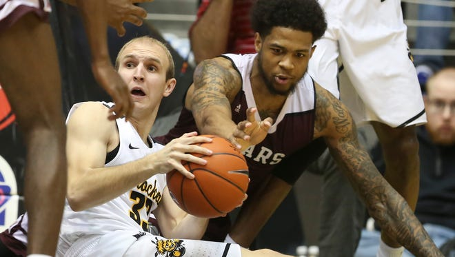 Wichita State guard Conner Frankamp fights for a loose ball against Missouri State forward Obediah Church during the first half of their game on Thursday night at Koch Arena.