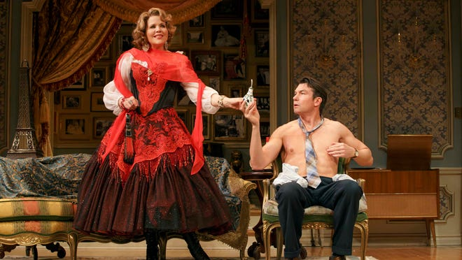 Renée Fleming, left, and Jerry O'Connell appear during a performance of Living on Love at the Longacre Theatre in New York.