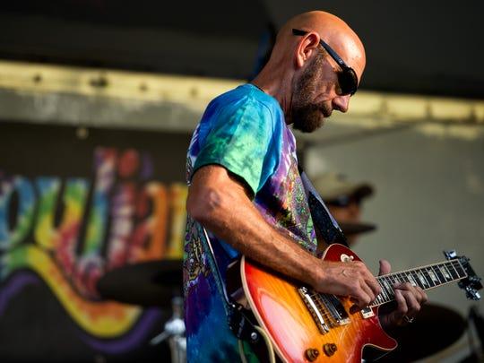 John Carpenter plays lead guitar with SoulJam. The