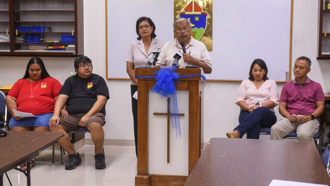 """Greg Calvo, with his wife Frances by his side, talks about their involvement with the Couples for Christ marriage ministry at their church, during an """"Unpdating the Faithful"""" briefing in the St. John Paul the Great Center for Evangelization on Wednesday, Aug. 2, 2017. The Calvo's, married for 44 years, were joined at the briefing by couples, Winnie and Frank Taijito, left, married for 11 years, and Christine and Richard Rosario, who celebrated their 20th wedding anniversary on the date of the briefing."""