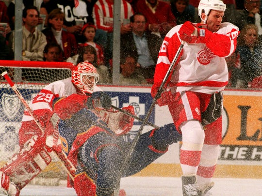 Red Wing Vladimir Konstantinov sends an unidentified St. Louis Blue player onto the ice during first period action at Joe Louis Arena on April 25, 1997.