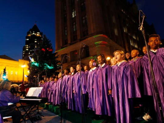 Local choirs are part of the entertainment at the kickoff to the downtown Milwaukee annual holiday lights festival.