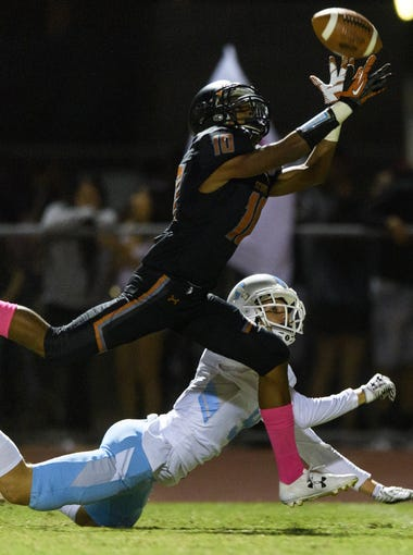 Desert Edge's Cliffonte Mcdowell (#10) almost intercepts a pass intended for Deer Valley's Tyler Druszcz (#9) in the fourth quarter of their high school football game on Friday, Oct.20, 2017, at Desert Edge High School in Goodyear, Ariz.