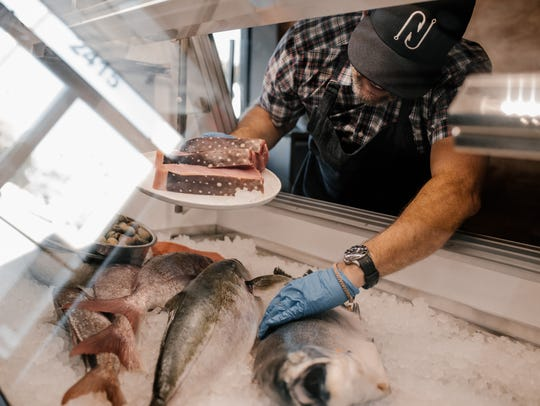 o Nelson's Meat + Fish sells seafood and meat to take
