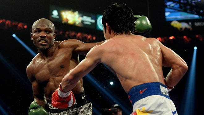 Timothy Bradley (green gloves) and Manny Pacquiao (red gloves) during their WBO World Welterweight Championship fight at MGM Grand Garden Arena. Manny Pacquiao won by unanimous decision.