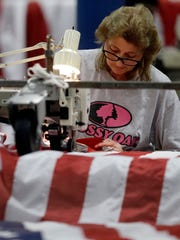 Lennis Waller sews United States flags at Annin Flagmakers